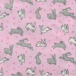 Tissu coton lièvres fond rose glitter