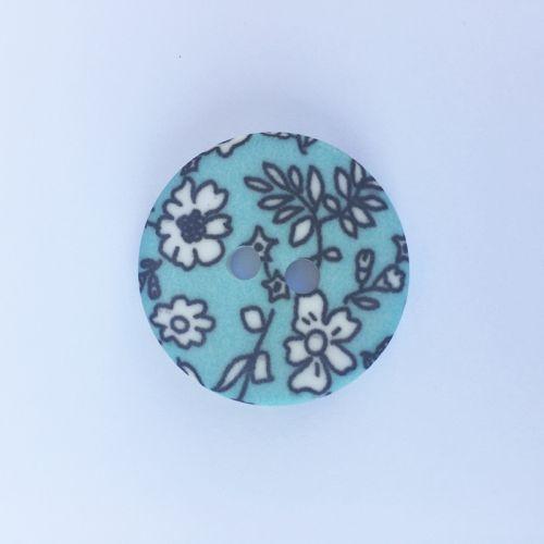 Bouton fleuris plastique bleu 27 mm
