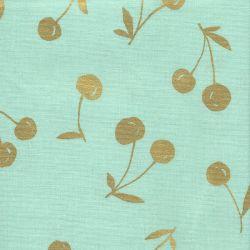 Tissu coton lin cerises dorées fond vert amande