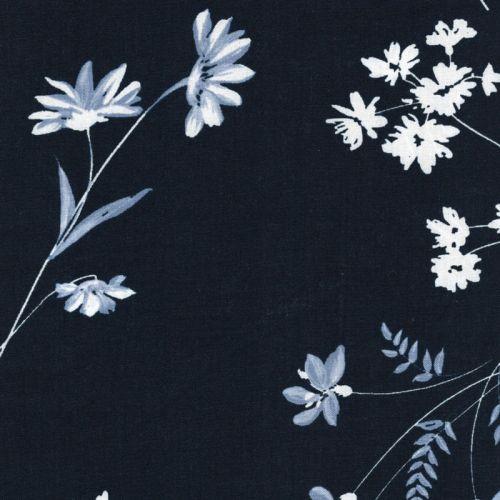 Tissu fleurs blanches et bleues fond marine