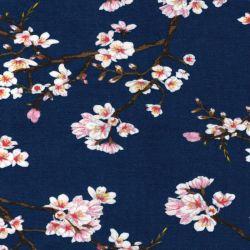 Tissu jersey Sakura fond bleu 95%cot/5%el larg 150 cm