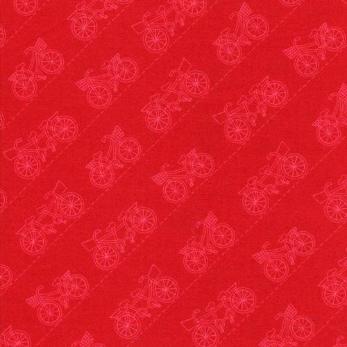 Tissu coton vélos dans les Alpes fond rouge