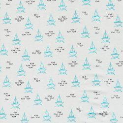 Tissu jersey petits bateaux fond bleu