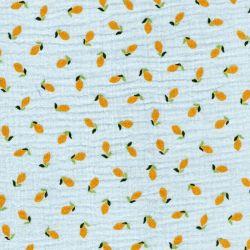 Tissu double gaze citrons fond bleu